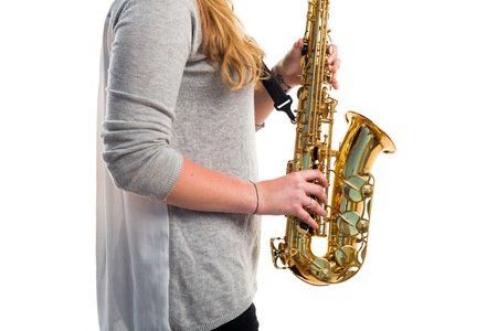 Girl playing the saxophone Stock Photo