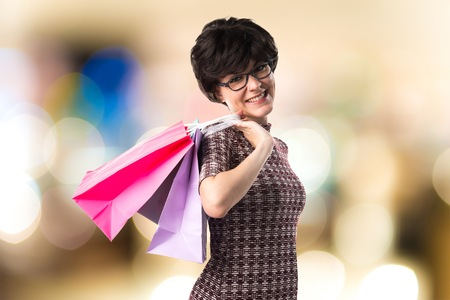 Woman with many shopping bags Stock Photo