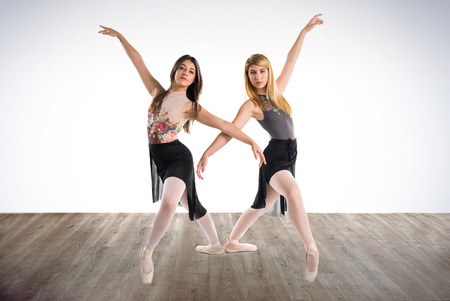 Two girls dancing ballet