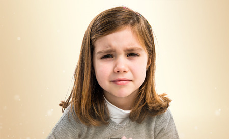 Sad blonde kid Stock Photo