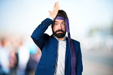 Crazy and drunk businessman having doubts on unfocused background Stock Photo