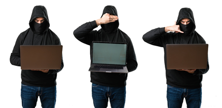 Set of Hacker with his computer covering his face and doing phone gesture