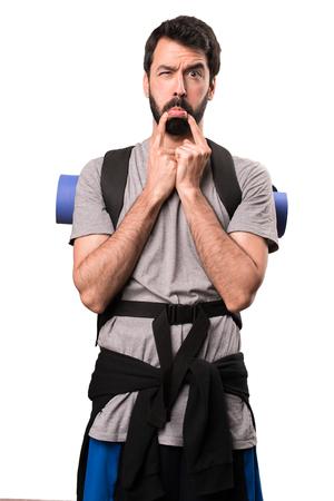 Sad handsome backpacker on white background Stock Photo