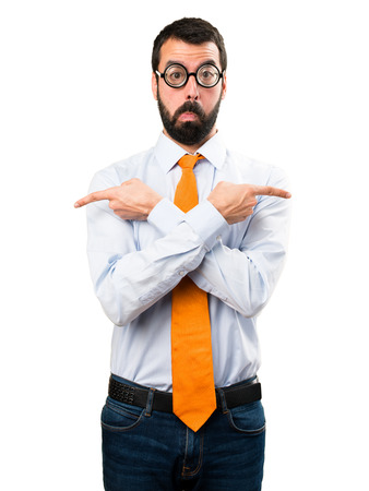Funny man with glasses pointing to the laterals having doubts Stock Photo