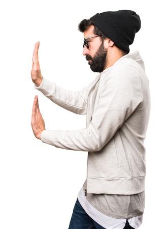 Hipster man pushing something on white background Stock Photo