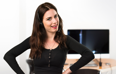 Telemarketer Happy beautiful young girl in the office