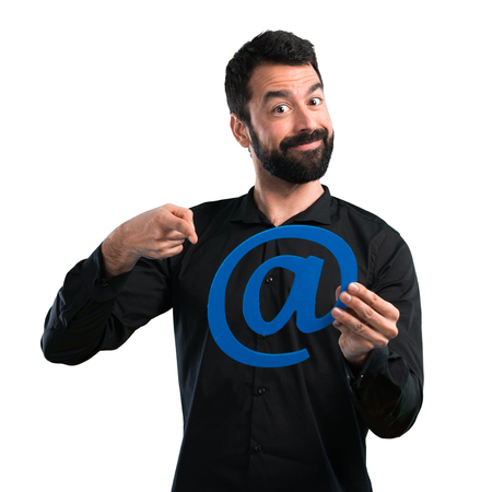 Handsome man with beard holding icon of at dot com on white background