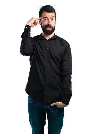 Handsome man with beard making crazy gesture on white background Stock Photo