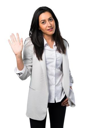 Pretty woman saluting on white background