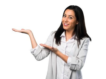 Pretty woman presenting something on white background Standard-Bild