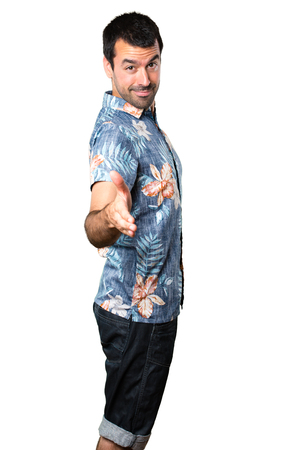 Handsome man with flower shirt making a deal on isolated white background