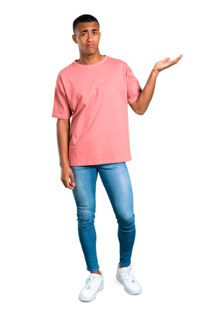 Standing young african american man unhappy and frustrated with something. Negative facial expression on isolated white background