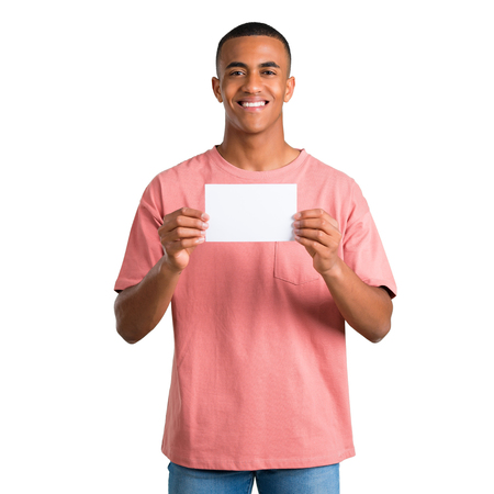 Young african american man holding an empty white placard for insert a concept on isolated white background Stock Photo