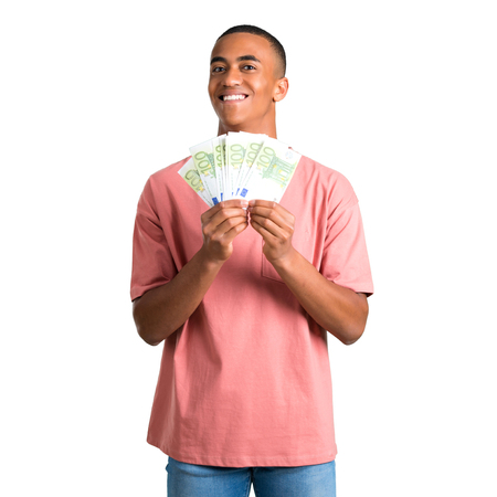 Young african american man taking a lot of money on isolated white background