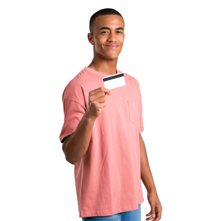 Young african american man holding a credit card on isolated white background