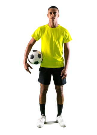 Soccer player man with dark skinned playing catching a ball with his hands on isolated white background