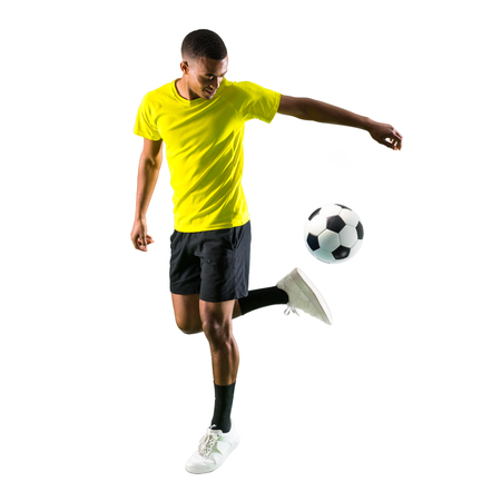 Soccer player man with dark skinned playing on isolated white background Stock Photo