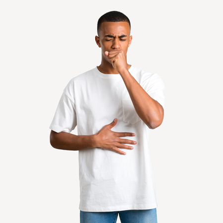 Young african american man is suffering with cough and feeling bad on isolated background Stock Photo