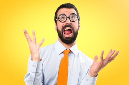 Frustrated funny man with glasses on colorful background