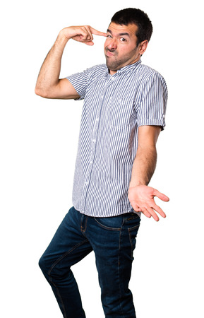 Handsome man making crazy gesture on isolated white background Stock Photo