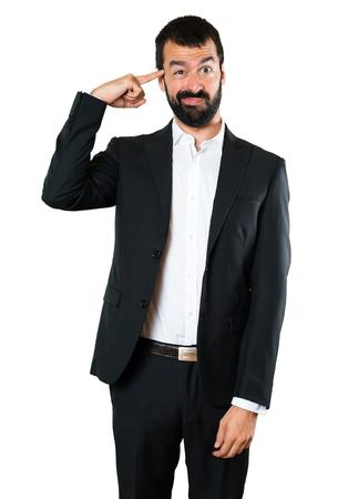 Handsome businessman making crazy gesture
