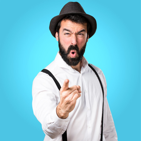 Hipster man with beard shouting on colorful background Foto de archivo
