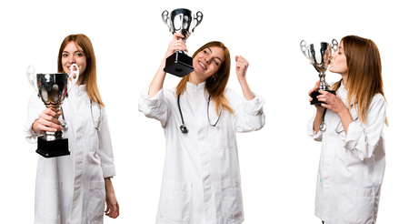 Set of Young doctor woman holding a trophy Stock Photo