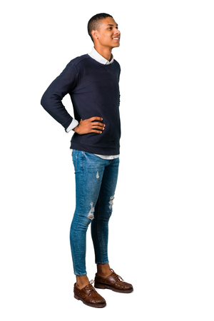 Young african american man standing and looking to the side on isolated white background. Ideal for use in architectural designs