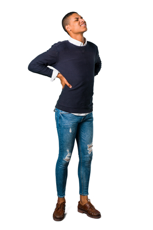 Young african american man with back pain on isolated white background