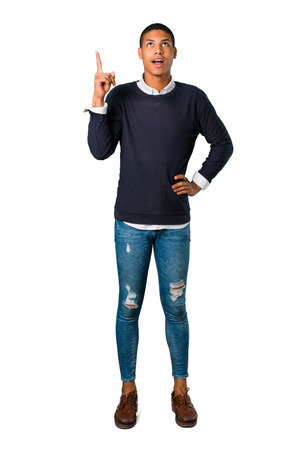 Young african american man standing and thinking an idea pointing the finger up on isolated white background Stock Photo