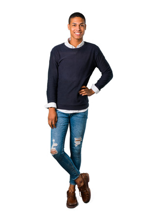 Young african american man posing with arms at hip and laughing looking to the front on isolated white background. Ideal for use in architectural designs