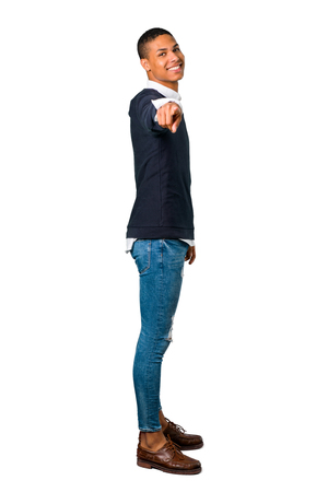 Young african american man points finger at you with a confident expression on isolated white background Stock Photo