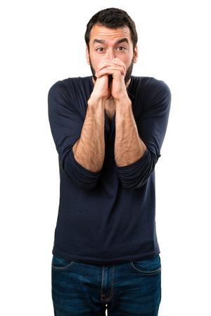 Handsome man with beard pleading Stock Photo