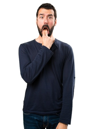 Handsome man with beard making vomiting gesture Stock Photo