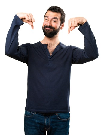 Handsome man with beard pointing down Foto de archivo