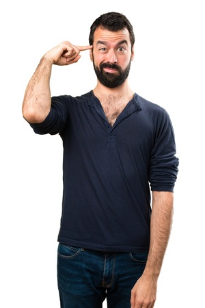 Handsome man with beard making crazy gesture