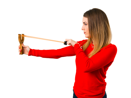 Young blonde woman with slingshot