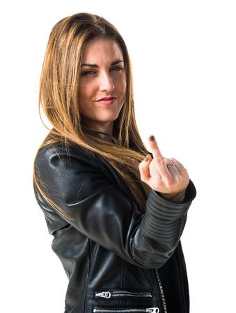 Woman making horn gesture