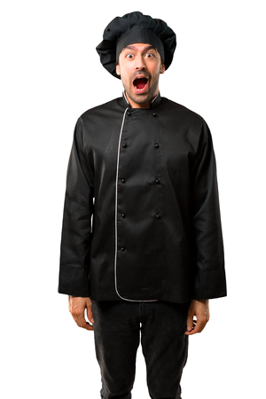 Chef man In black uniform with surprise and shocked facial expression. Gaping because have just surprised with a gift on isolated white background