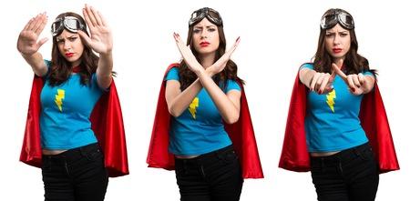 Set of Pretty superhero girl making NO gesture