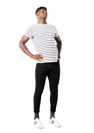 Full body of Dark skinned man with striped shirt with back pain on white background
