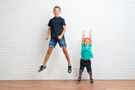 Two little brothers jumping