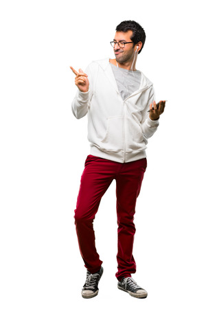 Full body of Man with glasses and listening music enjoy dancing while listening to music at a party on white background Stock Photo
