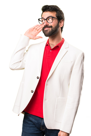 Brunette man with glasses listening something on white background
