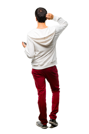 Full body of Man with glasses and listening music on back position looking back while scratching head on white background