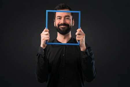 Handsome man with beard with framework on black background Stock Photo