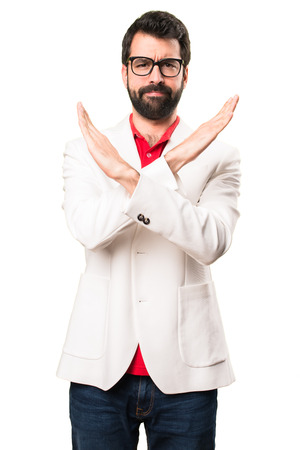 Brunette man with glasses making NO gesture on white background Stock Photo