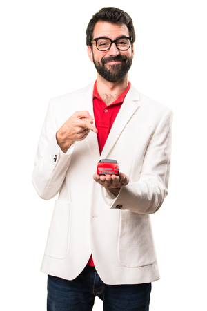 Happy Brunette man with glasses holding little car on white background Stock Photo