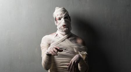 Terrorific mummy on textured wall background.  Halloween holidays Stock Photo