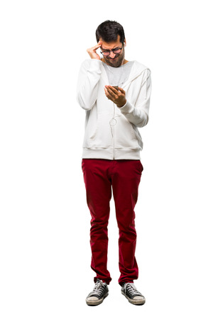 Full body of Man with glasses and listening music unhappy and frustrated with something. Negative facial expression on white background